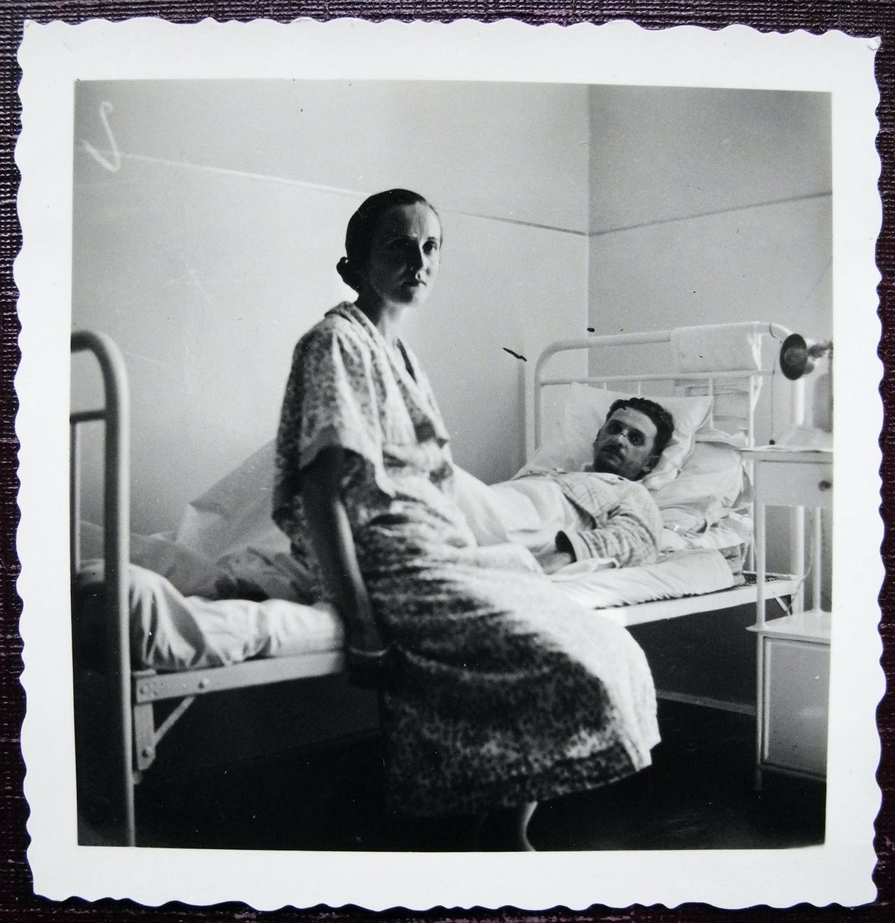 vintage photo of hospital patient with visitor